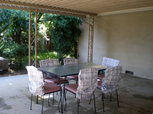 The clean patio with chairs back in place