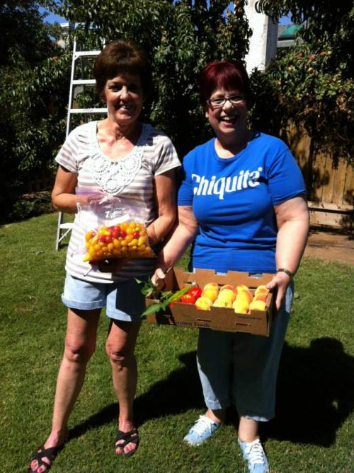 Gladys and me in her backyard with more summer fruit.