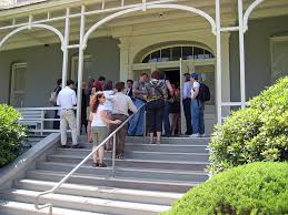 A tour group lining up on the front steps
